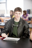 School Science. Teenage boy in science class wearing proper safety equipment — Stock Photo