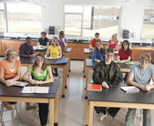 School Science. Students put on safety goggles and gloves to prepare for dissection in science class. — Stock Photo