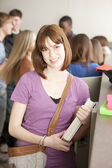 Education. Teenage high school student standing at her locker — Stock Photo