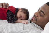 African american father sleeping quietly with his baby son — Foto Stock