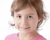Real. Caucasian smiling little real gir with brown hair and brown eyes — Stock fotografie