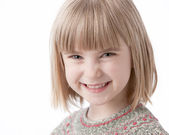 Real. Caucasian smiling little girl with blond hair — Stock Photo