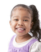 Mixed race smiling little girl with long hair — Stock Photo