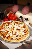 Food and Drink. All Meat Pizza with Red Wine — Stock Photo