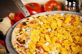 Food and Drink. A zesty taco pizza. — Stock Photo
