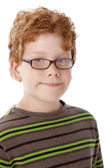 Caucasian smiling little real boy with red hair and glasses. — Stock Photo