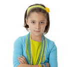 Caucasian little girl wearing vibrant colorful clothes and accessories — Stock Photo