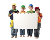 Diversity. Group of four diverse little boys holding a blank white sign to customize — Stock Photo