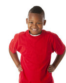 Real. Black little boy wearing a bright red shirt with his hands on his hips — Stock Photo