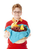 Healthy Eating. caucasian little boy with red hair and glasses holding a basket arranged with fresh fruits — Stock Photo