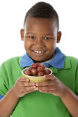 Healthy Eating. Black little boy holding a bowl of fresh juicy grapes — Stock Photo