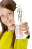 Healthy Eating. Caucasian little girl holding a cold fresh bottle of water — Stock Photo