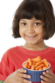 Healthy Eating. Mixed race little girl holding a bowl of carrots — Stock Photo