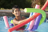 Summer Swimming. Group of little boys playing together in the summer sun with water toys — Stock Photo