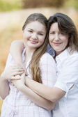 Real. Caucasian mother hugging her teenage daughter — Stock Photo