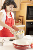 Baking. Mixed race young adult woman making a fresh apple pie — Stock Photo