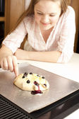 Baking. Caucasian teenage girl getting ready to taste the fresh homemade fruit dessert — Stock Photo
