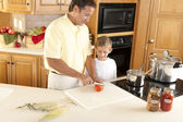 Canning. Father and son canning homegrown fruits and vegetables — Stock Photo