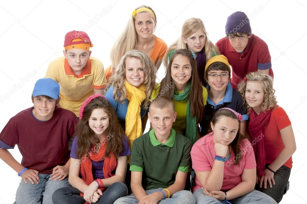 Diversity. Group of teenage girls and boys sitting together in ...