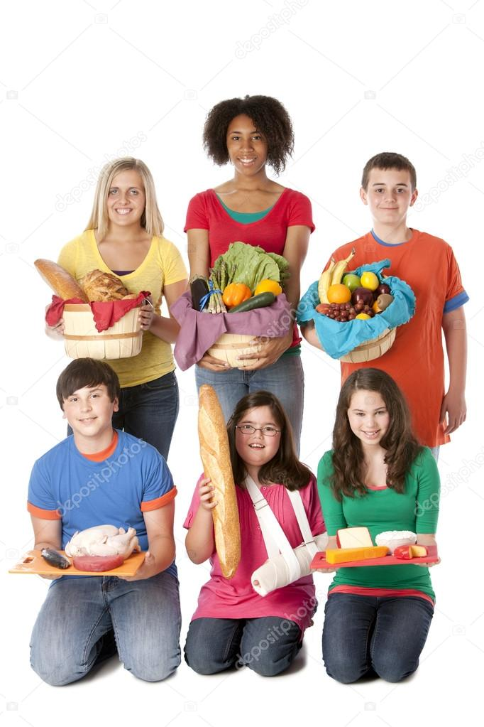 Teenage girls and boys holding baskets with the food groups of fruits
