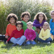 Mixed race children from a large family - Stock Photo