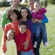 Stock Photo: Mixed race caucasian and african american group of brothers and sisters