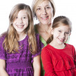 Stock Photo: Caucasian mother and her two daughters