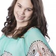 Smiling caucasian teenage girl with long brown hair — Stock Photo