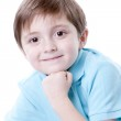 Smiling caucasian little boy resting his chin on his hand. — Stock Photo