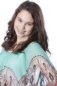Smiling caucasian teenage girl with long brown hair — Stock Photo
