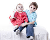 Caucasian little boy and his baby girl sister — Stock Photo