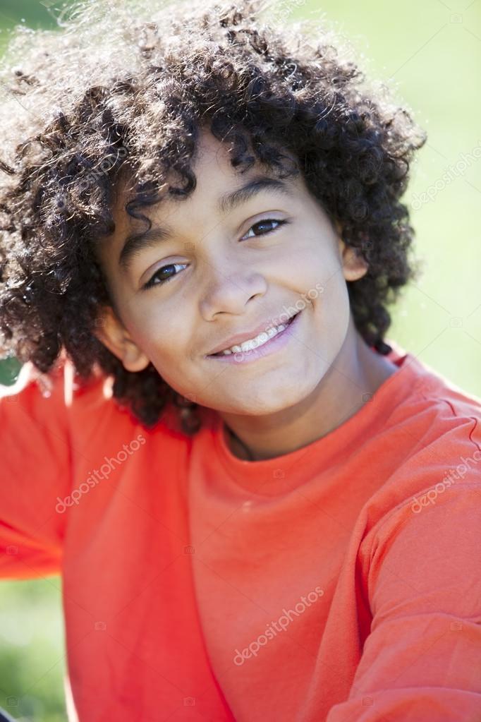 Mixed Race Little Boy Sitting Sun