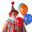 Clowns. Adult male clown holding colorful helium balloons - Stock Photo