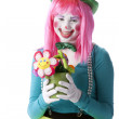 Clowns. Young teenage clown holding a flower pot — Stock Photo