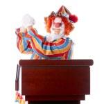 Clowns. Adult clown standing at a podium giving a speech — Stock Photo #21424133