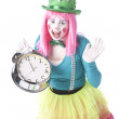 Clowns. Young  teenage female clown holding a big alarm clock to show time — Stok fotoğraf