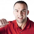 Caucasian young adult male with an angry expression — Stock Photo