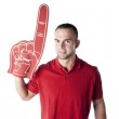 Sports Fans. Caucasian young adult male fan cheering with a foam number one finger — Stock Photo