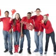 Sports Fans. Group of cheering teenagers standing together for the winning red team — Stock Photo #21425051