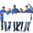 Sports Fans. Group of smiling teenagers cheering together as friends for the blue team - Stock Photo