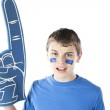 Sports Fans. Caucasion male sports fan roots for the blue team with foam finger and face paint. — Stock Photo #21425347