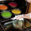 Stock Photo: Rainbow Cake. Chef putting pans into the oven to cook