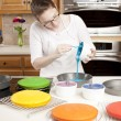 Rainbow Cake. Chef pouring batter into pans to make the colorful layers of a rainbow cake — Stock Photo