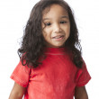 Smiling mixed race little girl with long hair and a bright red shirt — Stock Photo