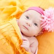 Awake caucasian newborn baby girl — Stock Photo