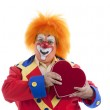 Close up of a professional male clown with crazy orange hair and a big heart — Stock Photo