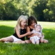 Young sisters in park - Stock Photo