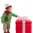 African American Toddler opens a Christmas present. — Stock Photo