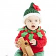A little baby boy makes toys in santas workshop — Stock Photo
