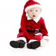 Little baby boy dressed like Santa Claus stares at camera — Stock Photo